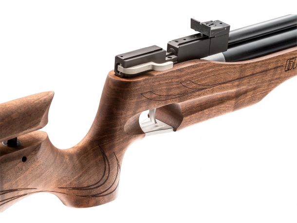 The wooden stock features a traditional competition pistol grip