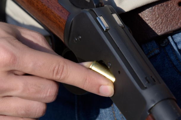 Cartridges are loaded through the loading port at side of the frame...