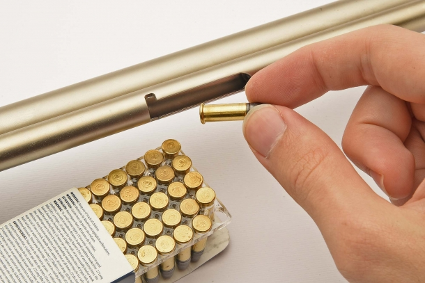 Cartridges are loaded one by one, via the loading window under the magazine tube
