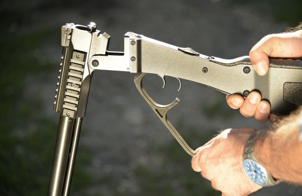 The gun breaks open by acting on the big lever protecting the triggers