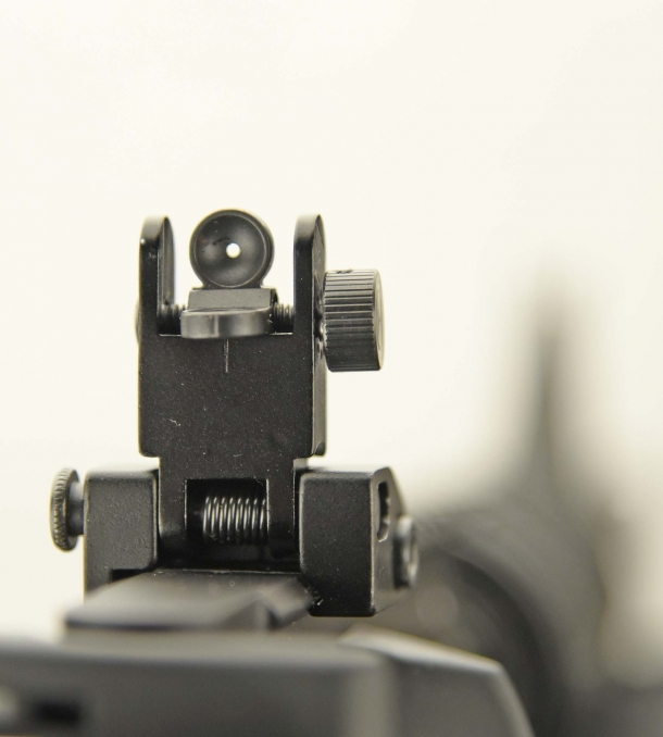 The Colt original flip-up adjustable rear sight (here with the small hole set)