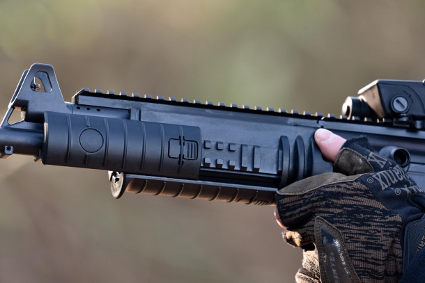 Polymer covers protect the rails at side and bottom of the rifle barrel