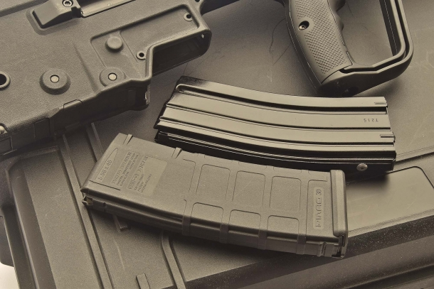 The X95 feeds through STANAG 4179 compliant AR-15 type magazines: hereby portrayed are a standard metal STANAG magazine and a polymer MagPul PMAG