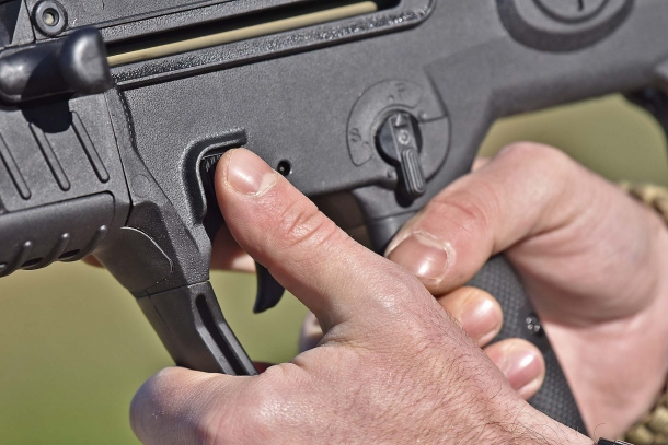 The magazine release button is located just above the trigger guard