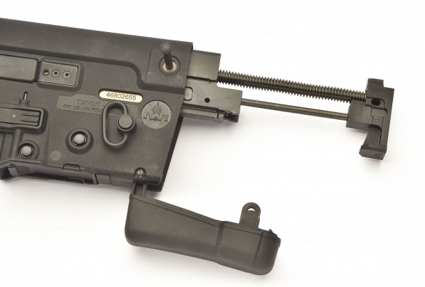 The buttpad dubs as the access port for the gas piston - bolt - bolt carrier group, which can be easily removed from its seat