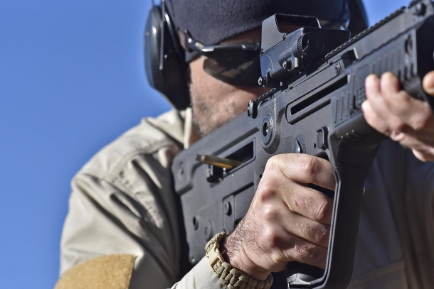 Unlike in conventional firearms, exhaust gases in a bull-pup rifle vent through the stock and out from the ejection window, very close to the shooter's face