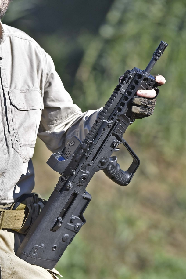 The X95 semi-automatic rifle is extremely compact and a pleasure to shoot; notice the full-length top Picatinny rail