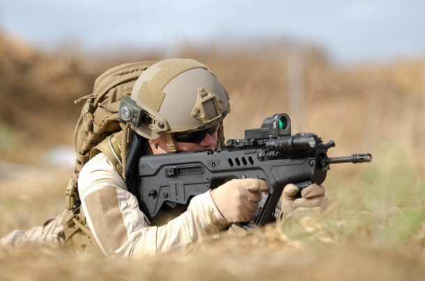 An operator fires the baseline Tavor TAR-21 bull-pup assault rifle