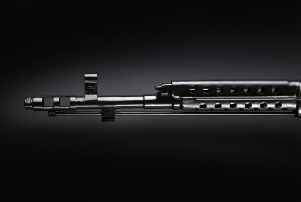 The barrel of the KO-SVT rifle features a prominent flash hider and muzzle brake