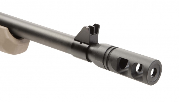 "A close-up of the protected, fixed front blade sight; the flash hider is removable from the 5/8x24"" threaded muzzle, making the Savage 110 Scout suppressor-ready"