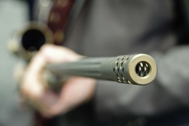 The fluted barrel is equipped with a muzzle brake installed on a threaded muzzle