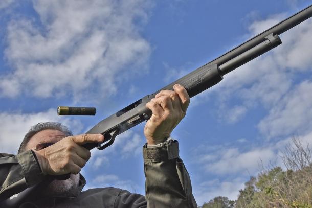 It's a slide action shotgun!