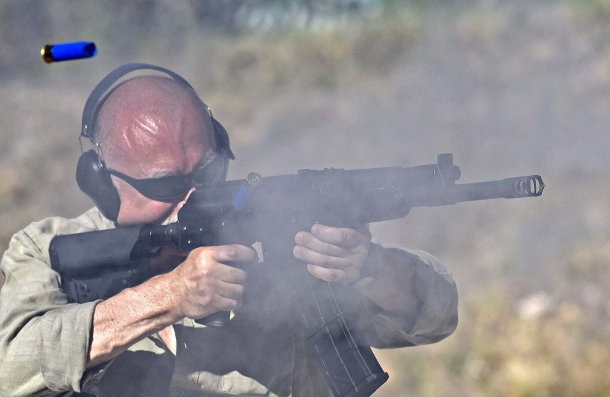 Behind the smoke: a series of quick shots from a 12/76 combat shotgun. A very convincing argument for anyone