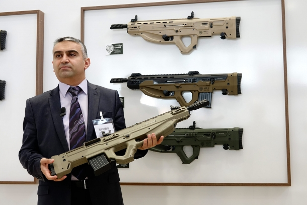 Ayhan Sekitaş, deputy director for Uzkon, showcases the UNG-12 at IWA