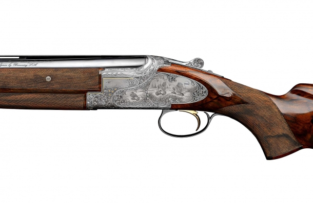 Left plate view of a finely engraved Browning B25 shotgun