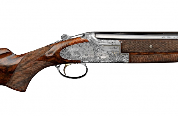 Right plate view of a finely engraved Browning B25 shotgun