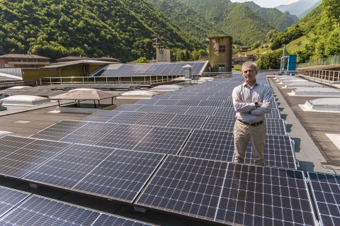 CEO Emanuele Sabatti posing satisfied in the middle of the company new photovoltaic solar energy plant