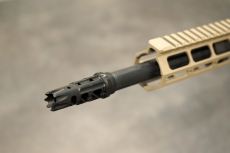 The flash hider of the BCM-15, attached to the muzzle of a multi-radially rifled barrel
